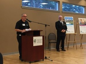 Habitat for Humanity spokesperson Pat McKenna accepts the donation from the CV Community Foundation
